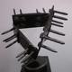 Stan Smokler's untitled pedestal sculpture bristles with spikes.