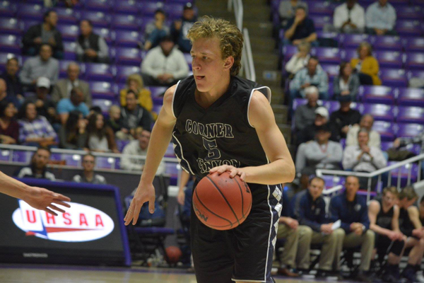 Senior Michael Scheffner looks to drive to the basket in the quarterfinals against Maple Mountain. Scheffner will graduate from the Charger program with the school record for points in a season. (Corner Canyon Basketball)