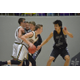 Sophomore John Mitchell prevents a Maple Mountain player from penetrating the Charger defense. When holding opponents under 60 points, Corner Canyon was 13-0. (Corner Canyon Basketball)
