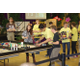 Beehive Robotics competes at the state First Lego League robotics tournament where they captured the robot performance title and repeated as state champions. (Julie Slama/City Journals)