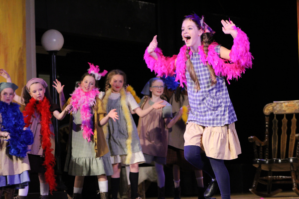 "Girls who are playing orphans dance during the song ""You're Never Fully Dressed Without a Smile"" in Riverton Art's Council production of Annie. (Tori La Rue/City Journals)"