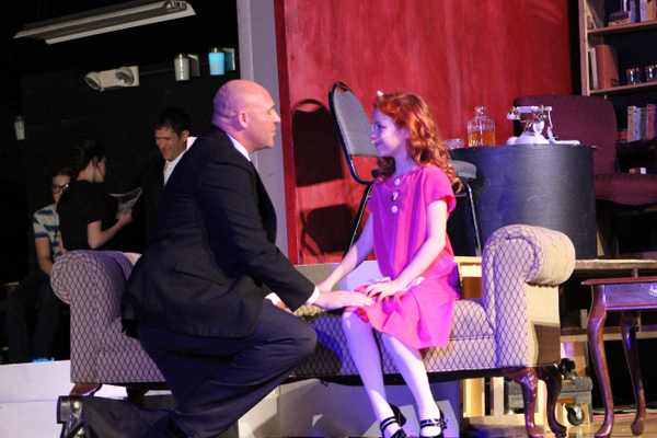 "Todd Young, playing the part of Oliver Warbucks, sings to Elizabeth Birkner, playing the part of Annie, in Riverton Art's Council's ""Annie."" (Tori La Rue/City Journals)"