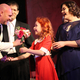 Playing the part of Oliver Warbucks, Todd Young hands a flower bouquet to Elizabeth Birkner, who portrays the role of Annie in Riverton Art's Council's production. (Tori La Rue/City Journals)
