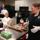 Belma Hrkovic instructs Amber Jackson how to slice the baguettes for her recipe. (Jet Burnham/City Journals)