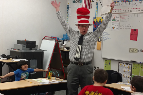 City Council member, Dirk Burton, gets wacky while reading Dr. Seuss. (Jet Burnham/City Journals)