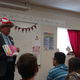 Farmer Gil Ma encourages students to make reading a priority in their lives. (Jet Burnham/City Journals)