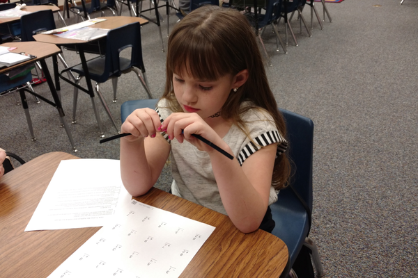 Sophie Rond compares numbers with manipulatives provided by her second grade teachers. (Jet Burnham/City Journals)