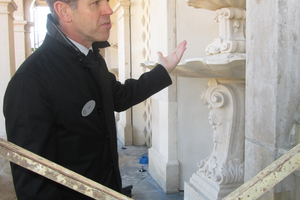 Paul Redman points out one of the restored features in the garden.