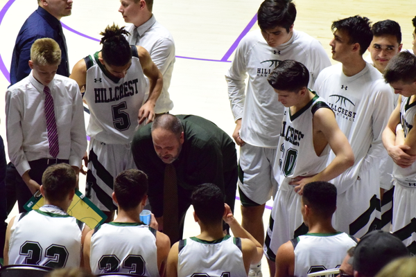 Head coach Sam Richins speaks with the team during a timeout of the 4A semifinals. Richins was an assistant coach the last time the team made it to the semifinals. (Suzanne Richins/Hillcrest Basketball)