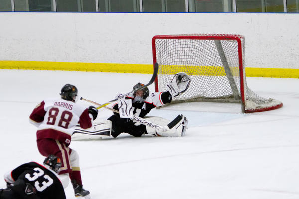 Murray goalie Mike Richins does the splits to stop the puck during the Spartans state semifinal win over Viewmont. (Murray hockey)
