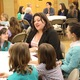 Salt Lake County Communications Director Stacee Adams speaks with Girl Scouts and their parents. (Travis Barton/City Journals)