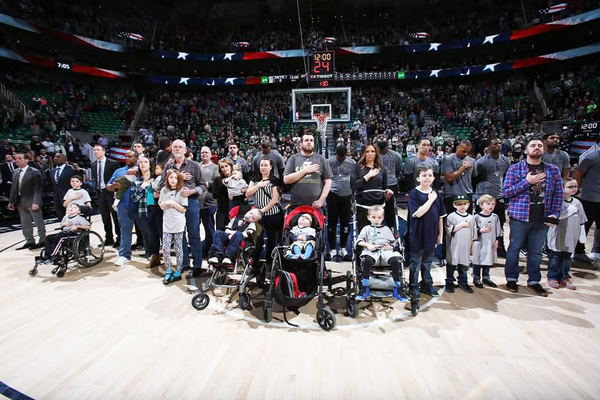 Children with rare and undiagnosed diseases got the chance to stand with the Utah Jazz during the national anthem. (Paul Asay/RUN).