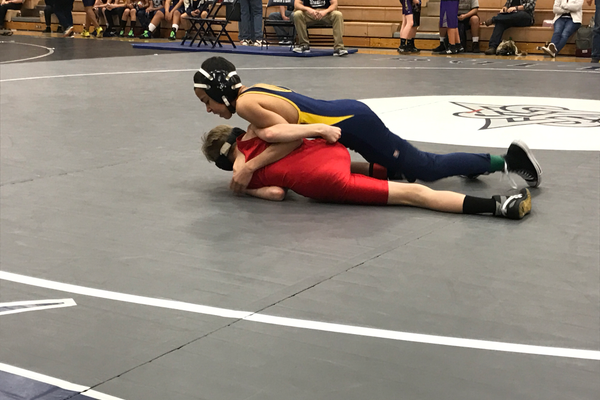 Hunter Junior High seventh grader Toby Chapman and Kennedy's Terrance Giles wrestled in the Granite School District 7-8 tournament, Giles won the match 8-2. (Greg James/City Journals)