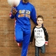 """Harlem Globetrotter """"Buckets"""" and Willow Canyon third-grader Qwade Rondeau team up to promote friendship at his school. (Tausha Rondeau/parent)"""