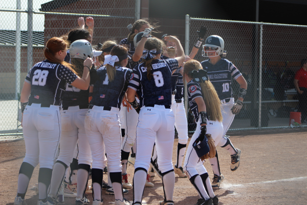 The team meets freshman Whitney Opheikens at the plate after she smashed a home run against Timpanogos. It was part of a back-to-back-to-back home run sequence for the Chargers. (Travis Barton/City Journals)
