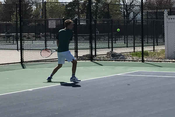 Parker Watts winds to return a serve during a practice doubles match. (Koster Kennard/ City Journals)