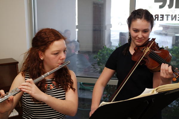 Olympus Jr. High students, Alice Flitton on flute and Kate Mayfield on violin, provide music for the diners. (Carla Dalton/Granite Food Services)