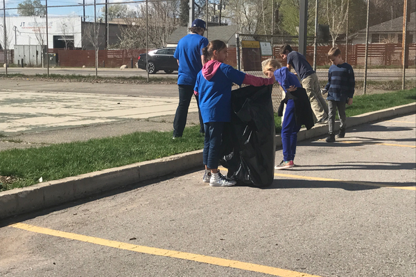 Third- and 4thfourth- grade students at The Boys and & Girls Club helped clean up garbage in the parking lot next to their building. (Natalie Mollinet/\City Journals)