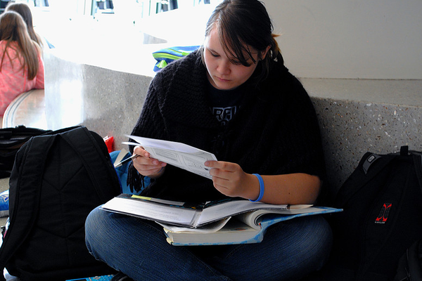 Senior Sam Nielsen studies between events at a debate tournament. (Hunter debate team)