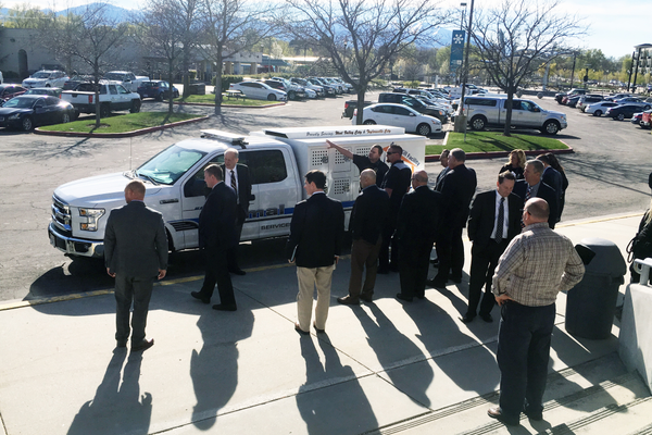 City officials gather round the new animal control vehicle as Nate Beckstead, Field field Supervisorsupervisor, points out the new features like an improved air flow system and increased number of kennels. (Travis Barton/City Journals)