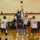 The championship of America's oldest high school alumni basketball tournament tips off. (Carl Fauver)