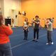 Jessie Ibrahim, founder of South Valley Youth Theater, coaches youth actors in their choreography. (Natalie Conforto/City Journals)
