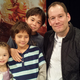 """Kiah, Gage and Kaden Maw met author Brandon Mull at the launch party for """"Dragonwatch."""" While reading """"Dragonwatch,"""" Kaden said he wished it would never end. (Taylor Maw)"""