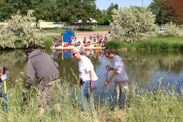 Volunteers help to keep the Jordan River corridor clean. (Jordan River Commission)