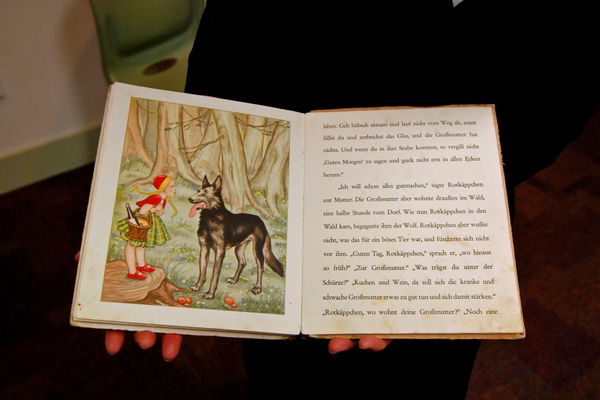 Illustrations of Little Red Riding Hood from 1930s copy of Grimm's Fairy Tales. (Keyra Kristoffersen/City Journals)