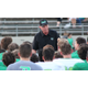 Head Coach Hal Wasson addresses his players during the 2017 Green-Wite Spring Game on May 18, at Dragon Stadium.