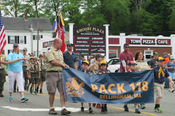 Members of Cub Scout Pack 118 hold their banner proudly as they march through Bellingham