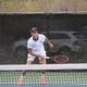 No. 1 singles player Drew Hartsfield serves against Skyline. (Travis Barton/City Journals)