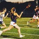 Kennedy Flavin runs with the ball in her net in a game during her junior year. (Brighton High School Yearbook)
