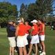 Brighton girls varsity golf team huddles with coach before the state tournament. (Clark Garso/ Brighton High School)