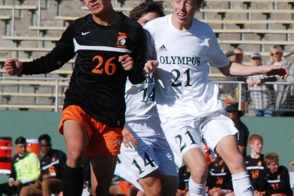 Jake Elwell heads the ball away from his Olympus opponent. (Murray Soccer Facebook)