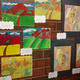 "Second-graders' pieces inspired by ""Tete d'une Femme Lisant,"" which means ""Head of a Woman Reading,"" by Pablo Picasso and ""Tahitian Landscape"" by Paul Gauguin. (Jet Burnham/City Journals)"