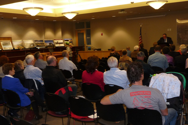 Taylorsville residents and elected officials look on during the mayor's speech. (Carl Fauver)