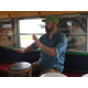 Nels Anderson teaches community members how to play drums from his bus. The Salt Lake City resident uses the bus as a mobile classroom. (Tori La Rue/City Journals)