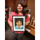 West Jordan high school senior Abril Susunaga shows off the portrait she made of a Bolivian child. (Jet Burnham/City Journals)
