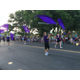 Riverton High School color guard students toss purple flags during the Town Days 2016 parade. (Tori La Rue/City Journals)