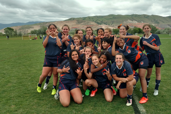 The girls throw up W's after winning their last game of their inaugural season. They defeated Kau Toa for third place in the state trophy tournament. (Christine Yee/ Girls Head Coach Brighton Rugby)
