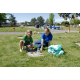 Henry Rieck and Nikki Rieck dig around gravestones to make them pretty for Memorial Day. (Keyra Kristoffersen/City Journals)