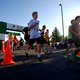 Teague Porter, first-place winner of the 5K, shows off his Summerfest bling. (Keyra Kristoffersen/City Journals)