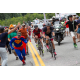 Cycling enthusiasts cheer their favorite riders coming through their hometown. (Jonathan Devich)