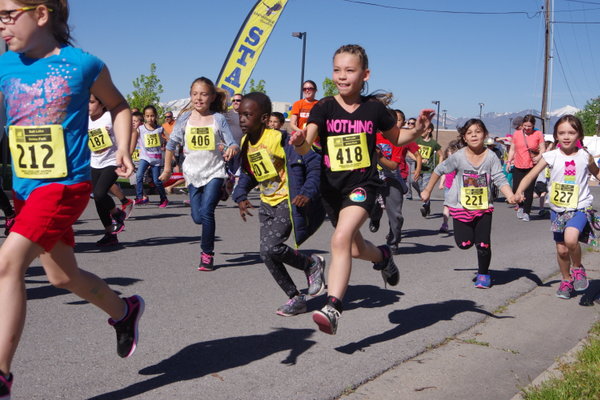 About 600 East Midvale students ran around the neighborhood to promote fitness and raise funds for school field trips. (Julie Slama/City Journals)