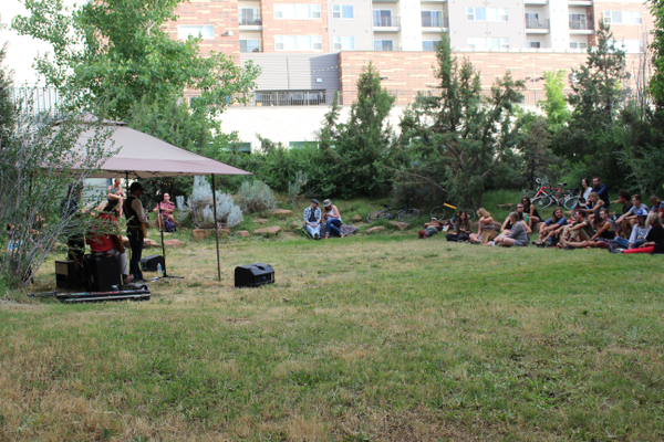 People sit and listen to Crook & The Bluff during the Hidden Hollow Concert Series. (Travis Barton/City Journals)