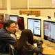 William Pettit assists students during web design lesson. (Allie Nannini/City Journals).