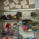 Hats are stored in a cabinet in the media center until December, when they are delivered to the Road Home Shelter. (Jet Burnham/City Journals)