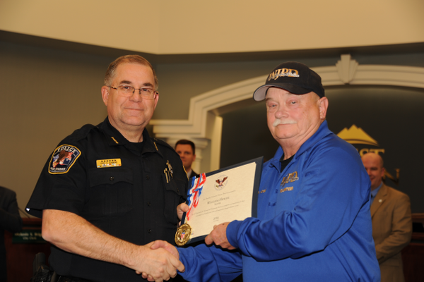 Hogue was presented with his certificate and medallion for his service from Police Chief Diamond. (Christie Jacobs/City of West Jordan )