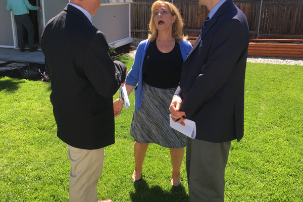Diane Warsoff of the CDCU speaks with Sam Johnson (left) and Steve Pastorik of WVC during the open house of the Idea House program. (Travis Barton/City Journals)